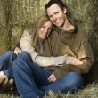 Hugging couple in hay. — Stock Photo