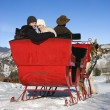 Young couple on sleigh ride. — Stock Photo