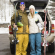 Stock Photo: Couple going skiing.