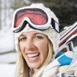 Woman going skiing. - Foto Stock