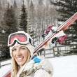 Smiling womwith skis. — Stock Photo #9226524
