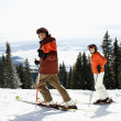 Couple Skiing on Mountain Slope - Lizenzfreies Foto