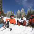 Skiers Sitting in Snow Talking — ストック写真
