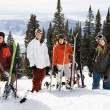 Skiers Standing in Snow Smiling — Stock Photo #9226595