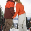 Ski Couple in Snow Holding Hands — Stock Photo