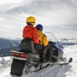 Stock Photo: Couple on snowmobile.