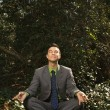 Royalty-Free Stock Photo: Young Businessman Sitting in Meditation