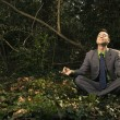Businessman Sitting in Meditation Outside — Stock Photo #9227137
