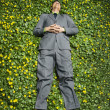 Young Businessman Lying in Flower Patch - Foto Stock