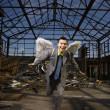 Businessman Wearing Angel Wings — Stock Photo #9227184