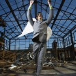 Businessman Wearing Angel Wings - Stockfoto