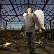 Stock Photo: Young Businessman With Angel Wings