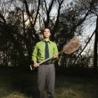 Stock Photo: Young BusinessmHolding Shovel