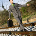 Businessman Walking on Railroad Tracks — Stock Photo #9227208