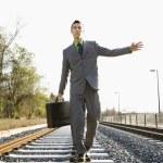 Businessman Walking on Railroad Tracks — Stock Photo