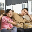 Royalty-Free Stock Photo: Couple watching TV.