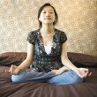 Stock Photo: Female meditating.