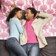 Couple laying on bed. - Stock Photo