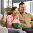 Stock Photo: Couple watching TV.