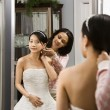 Friend helping bride. - ストック写真