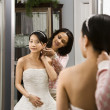 Friend helping bride. - Foto de Stock