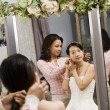 Friend helping bride. — Stockfoto