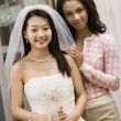 Bride and friend admiring dress. — Stockfoto