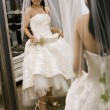 Bride looking at mirror. — Stock Photo