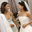 Bride and bridesmaid talking. — Стоковое фото