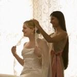 Bridesmaid placing veil. — Stock Photo