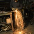 Metalsmith creating sparks. - Stock Photo