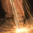 Metalsmith creating sparks. — Stock Photo