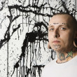 Stock Photo: Tattooed and pierced man.