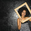Stock Photo: Woman holding frame.