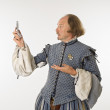 Shakespeare looking at phone. — Stock Photo