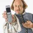 Stock Photo: Shakespeare holding cell phone.