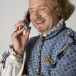 Stock Photo: Shakespeare talking on phone.