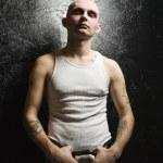 Punk holding buckle. — Stock Photo