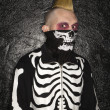 Stock Photo: Punk with skeleton costume.