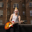 Foto Stock: Punk playing guitar.