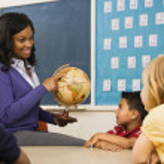 Teacher Holding Globe — Stock Photo