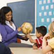 Teacher Holding Globe — Stock Photo