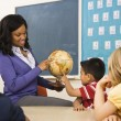 Teacher Holding Globe - Stock Photo