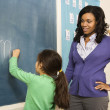 Teacher and Student at Blackboard — Stock Photo #9228267