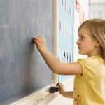 Girl Doing Math on Blackboard — Stock Photo
