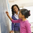 Teacher and Student at Blackboard — Stock Photo #9228277