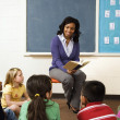 Teacher Reading to Students — Stockfoto #9228302
