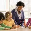Teacher Helping Students - Foto Stock