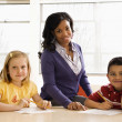 Teacher Helping Students With Schoolwork — Stock Photo