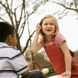 Young Girl and Boy Playing on Playground - Stock Photo